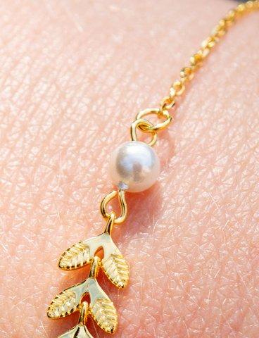 Gouden armband met witte parel van Goud op Zilver