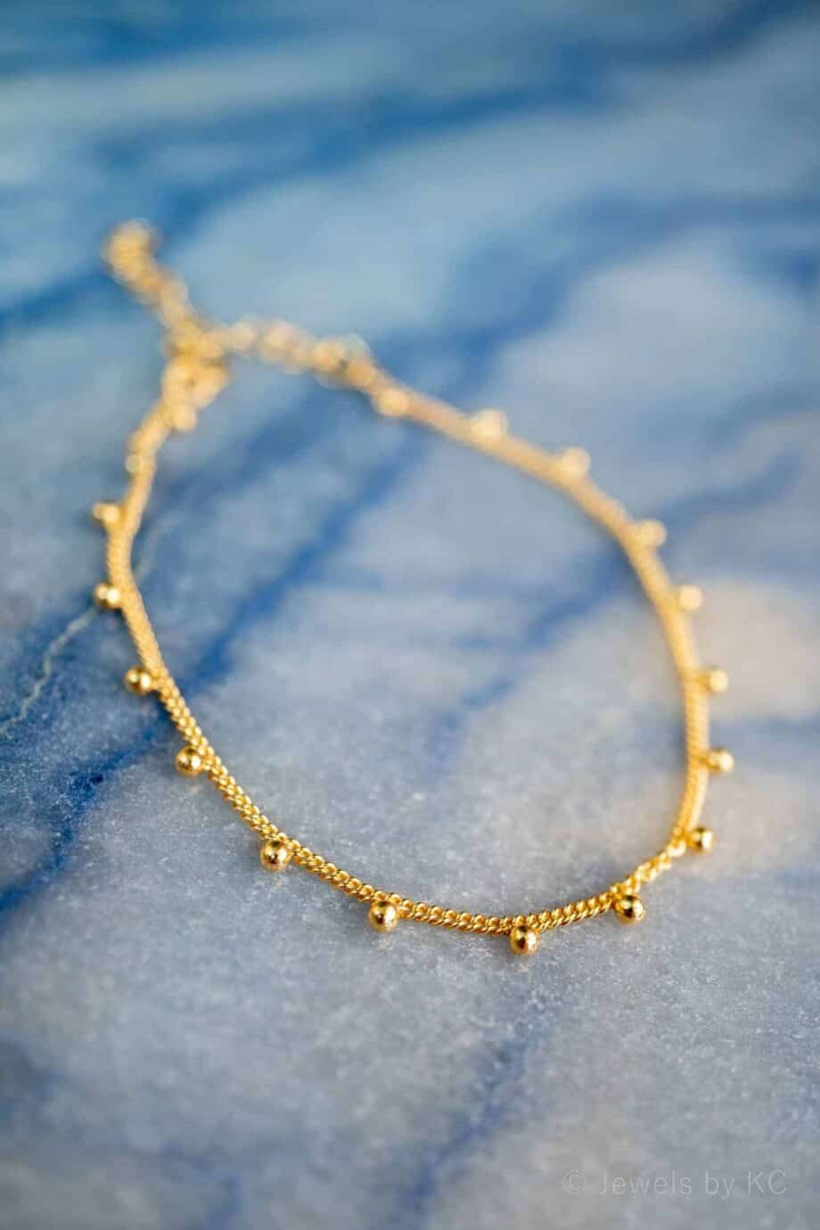 Gouden armband met balletjes 'Festival' van Goud op Zilver