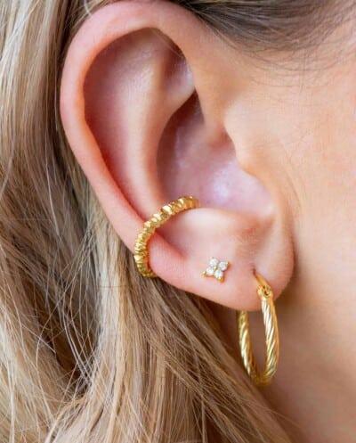 Gouden oorbellen 'Sparkle flower' van Goud op Zilver