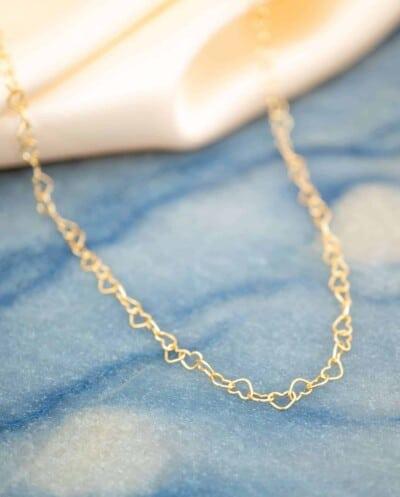 Gouden ketting 'Hartjes' van Goud op zilver