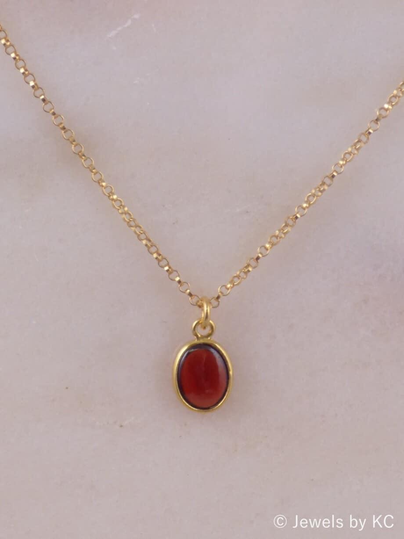 Gouden Goldfilled ketting met ovale rode granaat edelsteen van Goud op Zilver-zoom